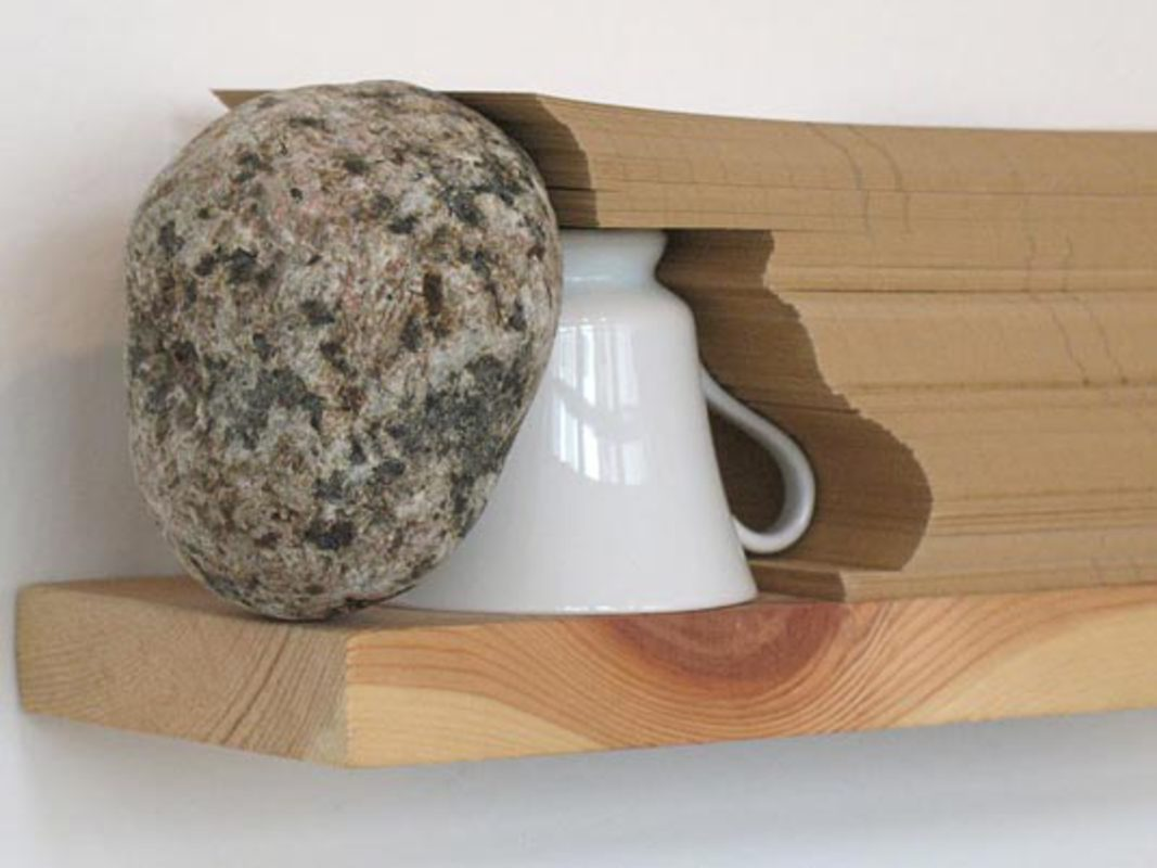 Café das Cinco, from the series Rack-Objects, 2009. Stone, wood, Paper and Bell, 10 x 31 x 9 cm